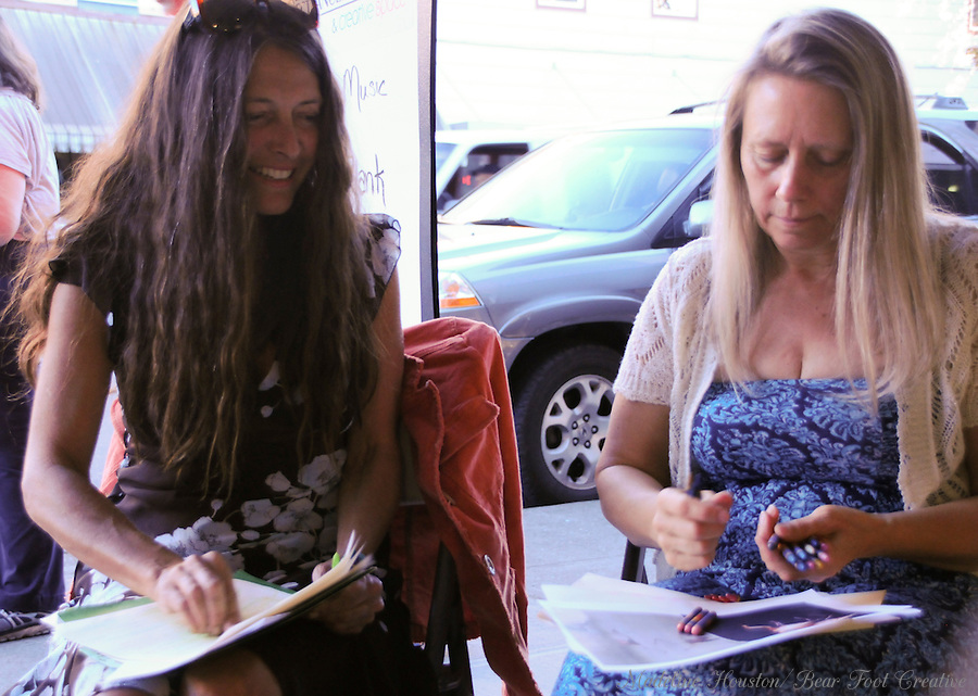 Artists Victoria Stewart and Jan Roe participate in the dueling flamingos paint-off, organized by the Rectangle Gallery during Centralia, Washington's Third Thursday on September 15, 2016.