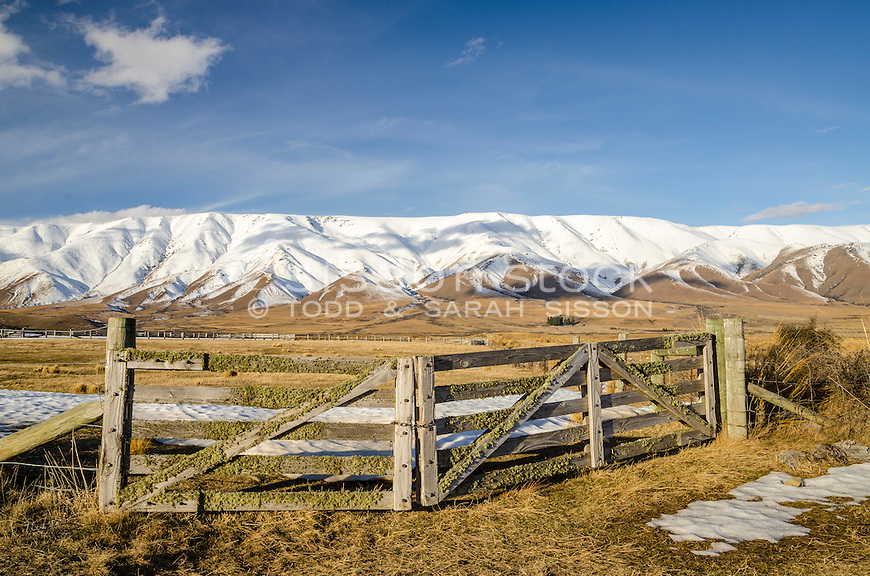 Farm gate and the Hawkdun ranges in winter, Central Otago, New Zealand - stock photo, canvas, fine art print