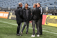 SEATTLE, WA - NOVEMBER 9: Seattle Sounders FC owner Adrian Hanauer talks with head coach Brian Schmetzer, general manger Garth Lagerwey, and technical directory Chris Henderson at CenturyLink Field on November 9, 2019 in Seattle, Washington.