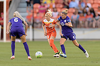Denise O'Sullivan (13) of the Houston Dash battles for control of the ball with Becky Edwards (14) of the Orlando Pride on Friday, May 20, 2016 at BBVA Compass Stadium in Houston Texas. The Orlando Pride defeated the Houston Dash 1-0.