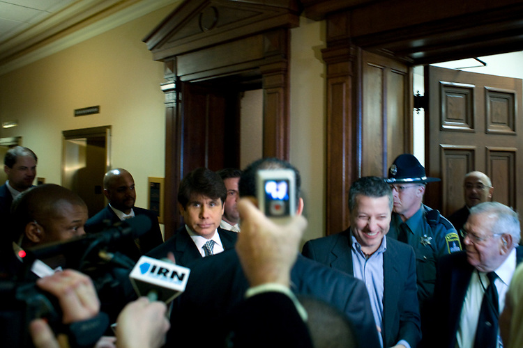 Illinois Governor Rod Blagojevich abruptly left out the back door of the Illinois State Capitol senate chamber after presiding over the senate inauguration ceremony in Springfield, Ill., January 14, 2009. The first business of the new senate was to move forward with Blagojevich's impeachment.