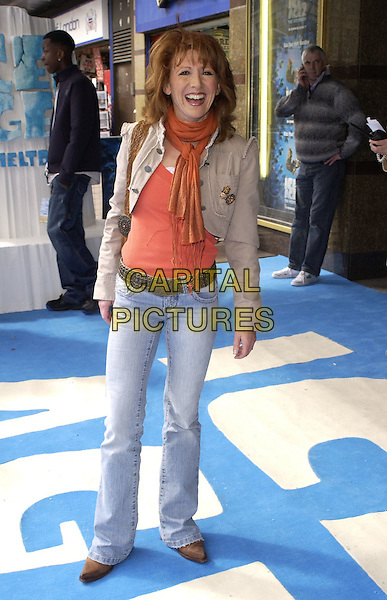 "BONNIE LANGFORD.At the UK Film Premiere of ""Ice Age 2: The Meltdown"",.Empire Cinema, Leicester Square, London, .England, April 2nd 2006..full length jeans orange top scarf.Ref: CAN.www.capitalpictures.com.sales@capitalpictures.com.©Can Nguyen/Capital Pictures"