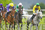 Kilbarry Beauty and jockey Paul Townsend centre get ready to make their winning sprint between  Urano ridden by Ruby Walsh left who finished second and  Tropical Three and AP Heskin  who finished third in the Killarney Towers Hotel Maiden  at the Killarney Races on Sunday