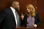 Nevada Assembly Democrats Jason Frierson and Marilyn Kirkpatrick talk on the Assembly floor at the Legislative Building in Carson City, Nev., on Monday, April 22, 2013. .Photo by Cathleen Allison