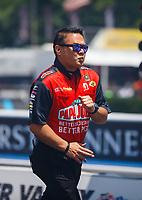 Jun 18, 2017; Bristol, TN, USA; Crew member Scott Okuhara for NHRA top fuel driver Leah Pritchett during the Thunder Valley Nationals at Bristol Dragway. Mandatory Credit: Mark J. Rebilas-USA TODAY Sports