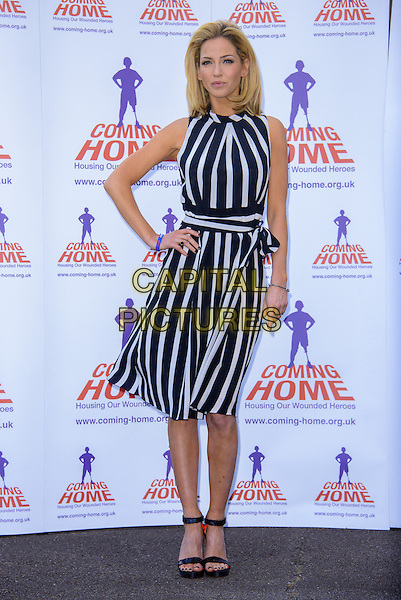 Sarah Harding.Is unveiled as the new ambassador for the armed forces charity 'Coming Home', which raises funds to provide homes for wounded soldiers returning from war zones, London, England..23rd April 2013 .full length dress white blue black stripe sleeveless hand on hip open toe ankle strap shoes .CAP/CJ.©Chris Joseph/Capital Pictures.
