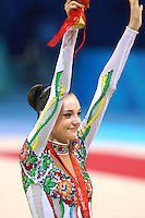 August 23, 2008; Beijing, China; Rhythmic gymnast Anna Bessonova of Ukraine celebrates taking bronze in the Individual All-Around final at 2008 Beijing Olympics..
