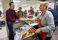 NWA Democrat-Gazette/BEN GOFF @NWABENGOFF<br /> John Huskins and Jarie Ripelmeyer, both from Bentonville, volunteer to serve meals Thursday, Nov. 28, 2019, during the community Thanksgiving meal at the Salvation Army Emergency Shelter in Bentonville.