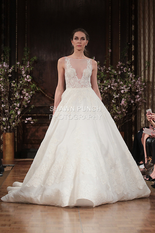"""Model walks runway in a """"Robyn"""" bridal gown from the Isabelle Armstrong Spring Collection 2017, at Lotte New York Palace Hotel, during New York Bridal Fashion Week Spring Summer 2017 on April 16, 2017."""