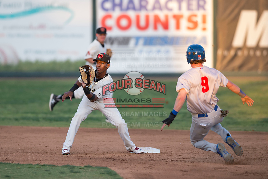 Visalia Rawhide second baseman Raymel Flores (1) prepares to catch a throw on a stolen base attempt by Skye Bolt (9) during a California League game against the Stockton Ports at Visalia Recreation Ballpark on May 8, 2018 in Visalia, California. Stockton defeated Visalia 6-2. (Zachary Lucy/Four Seam Images)