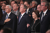 U.S. Vice President Mike Pence, former President George W. Bush, former first lady Laura Bush and former Florida Governor Jeb Bush watch as the casket of former President George H.W. Bush arrives to lie in state in the U.S. Capitol Rotunda in Washington, U.S., December 3, 2018. <br /> CAP/MPI/RS<br /> &copy;RS/MPI/Capital Pictures