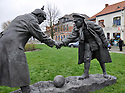 25/12/14<br /> <br /> A sculpture depicting two WW1 soldiers playing football during the famous Christmas Day truce is displayed in the field near Messine, Belgium, close to where the match was played in Flanders, Belgium.<br /> <br /> The sculpture, made in England, arrived in Flanders on Christmas Eve, and was first displayed in the town centre before being taken to the spot where the match was played. <br /> <br /> Sculpted by Andy Edwards the work is entitled &lsquo;All Together Now&rsquo;, recalling the song by the band The Farm - which was inspired by the truce. <br /> <br /> Chris Butler said: &ldquo;Castle Fine Arts are proud to have cast a number of war memorials over the years. We are honoured to support this sculpture for peace. I believe it will touch the hearts of millions.&rdquo;<br /> <br /> <br /> &ldquo;It will be a symbol of peace and hope and a call for a renewed worldwide cessation of violence in honour of those brave boys who &lsquo;joined together and decided not to fight&rsquo;&rdquo;.<br /> <br /> <br /> The statue depicts the meeting of a British and a German soldier over a football, deep in the mud between the lines on that first Christmas of the war. The soldiers appear to be shaking hands but  are not not quite touching, forming a space in which a visitor can insert their own hand to complete the union.  A chance for a moments reflection on how far we are from true peace and brotherhood and the part each of us has to play in that dream. We want the work to stand as both a celebration of this inspirational and heroic event and as symbol of hope and peace. <br /> <br /> The project was instigated some years ago, with the support of the Football Asscociation (FA), as football&rsquo;s contribution to the First World War commemorations. <br /> <br /> All Rights Reserved - F Stop Press. www.fstoppress.com. Tel: +44 (0)1335 300098