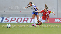 Katarina Naumanen of Finland battles with Guro Reiten of Norway during the UEFA Womens U19 Championships at Parc y Scarlets, Monday 19th August 2013. All images are the copyright of Jeff Thomas Photography-www.jaypics.photoshelter.com-07837 386244-Any use of images must be authorised by the copyright owner.