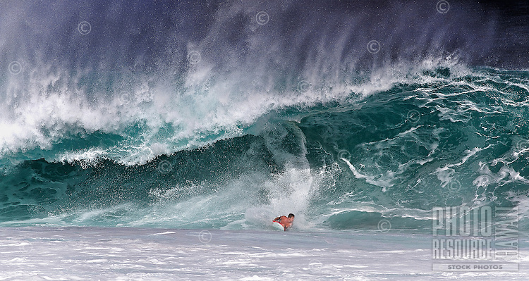 Bodyboarder in the pipe at the Banzai Pipeline on North Shore of Oahu.