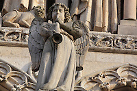 Statue of an angel blowing a trumpet in front of the Gallery of Kings on the Western facade of the Basilique Cathedrale Notre-Dame d'Amiens or Cathedral Basilica of Our Lady of Amiens, built 1220-70 in Gothic style, Amiens, Picardy, France. Amiens Cathedral was listed as a UNESCO World Heritage Site in 1981. Picture by Manuel Cohen