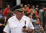 Saugerties Police Chief L.G. Barberia on duty on Partition Street during The Great Saugerties Bed Race part of Old Timers Day in Saugerties, NY on Saturday, August 6, 2011. Photo by Jim Peppler. Copyright Jim Peppler/2011.