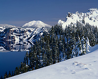 67ORCL_01 - USA, Oregon, Crater Lake National Park, Winter snow accumulates at Crater Lake and on distant Mount Scott.