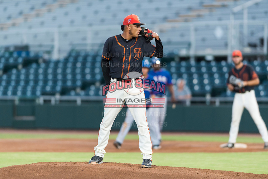 AZL Giants Black starting pitcher Israel Cruz (34) looks in for the sign during an Arizona League game against the AZL Rangers at Scottsdale Stadium on August 4, 2018 in Scottsdale, Arizona. The AZL Giants Black defeated the AZL Rangers by a score of 6-3 in the second game of a doubleheader. (Zachary Lucy/Four Seam Images)