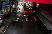 A pedestrian crosses the street at Bukit Bintang in Kuala Lumpur, Malaysia. Photo: Sanjit Das/Panos