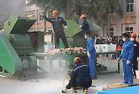 A handout photo from the Hong Kong-based 'AquaMeridian Conservation and Education Foundation' shows 6.2 tonnes of confiscated ivory prior being crushed by China forestry and customs officials and under the supervision of China's State Forestry Administration, Huangpu Port, Dongguan, China, 06 January 2014. After the United States, Philippines, Gabon, Kenya and Zambia, China is the latest country to crush its confiscated ivory as a symbolic gesture, sending a message to consumers, traffickers and poachers in Africa and Asia that the ivory trade is wrong and will make Africa's last remaining elephant populations extinct within 15 years. Scientists estimate that 25,000 elephants were illegally killed in 2012.