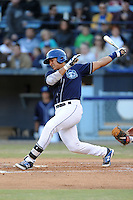 Asheville Tourists catcher Jose Briceno #4 swings at a pitch during a game against the Hickory Crawdads at McCormick Field on April 17, 2014 in Asheville, North Carolina. The Crawdads defeated the Tourists 6-1. (Tony Farlow/Four Seam Images)