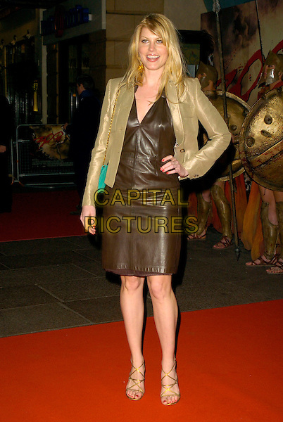 "MEREDITH OSTRUM.UK Premiere of ""300"" at Vue West End, Leicester Square, London, UK..full length black leather dress gold metallic jacket ostrom hand on hip green bag purse.CAP/CAN.©Can Nguyen/Capital Pictures"