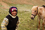 Domestic Horse (Equus caballus) and Kyrgyz boy, Pikertyk, Tien Shan Mountains, eastern Kyrgyzstan