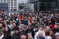 """Etwa 2.000 rechtsradikale Menschen demonstrierten am Samstag den 12. Maerz 2016 in Berlin unter dem Motto """"Merkel muss weg!"""" gegen Angela Merkel, gegen Fluechtlinge und fuer """"Das deutsche Vaterland"""".<br /> Bis auf wenige Ausnahmen waren angereisten Teilnehmer Neonazis und Hooligans, NPD-, Pediga- und AfD-Mitglieder.<br /> Aufgerufen zu dem Aufmarsch hatten die Hooligan-Gruppen """"Buendnis fuer Deutschland"""" und """"Buendnis fuer Berlin"""".<br /> Im Bild: Es wird ein Schild mit der Aufschrift """"Schluss mit der Merkel Diktatur"""" hochgehalten.<br /> 12.3.2016, Berlin<br /> Copyright: Christian-Ditsch.de<br /> [Inhaltsveraendernde Manipulation des Fotos nur nach ausdruecklicher Genehmigung des Fotografen. Vereinbarungen ueber Abtretung von Persoenlichkeitsrechten/Model Release der abgebildeten Person/Personen liegen nicht vor. NO MODEL RELEASE! Nur fuer Redaktionelle Zwecke. Don't publish without copyright Christian-Ditsch.de, Veroeffentlichung nur mit Fotografennennung, sowie gegen Honorar, MwSt. und Beleg. Konto: I N G - D i B a, IBAN DE58500105175400192269, BIC INGDDEFFXXX, Kontakt: post@christian-ditsch.de<br /> Bei der Bearbeitung der Dateiinformationen darf die Urheberkennzeichnung in den EXIF- und  IPTC-Daten nicht entfernt werden, diese sind in digitalen Medien nach §95c UrhG rechtlich geschuetzt. Der Urhebervermerk wird gemaess §13 UrhG verlangt.]"""