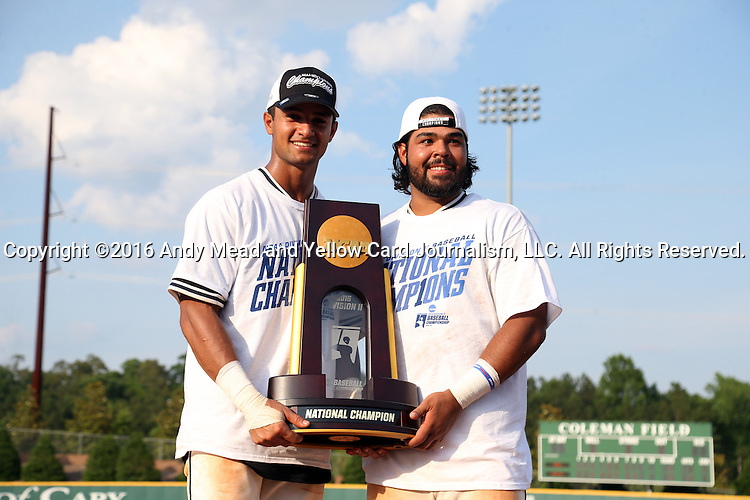 04 June 2016: Nova Southeastern's Sebastian Diaz (left) and Andres Visbal (right). The Nova Southeastern University Sharks played the Millersville University Marauders in Game 14 of the 2016 NCAA Division II College World Series  at Coleman Field at the USA Baseball National Training Complex in Cary, North Carolina. Nova Southeastern won the game 8-6 and clinched the NCAA Division II Baseball Championship.