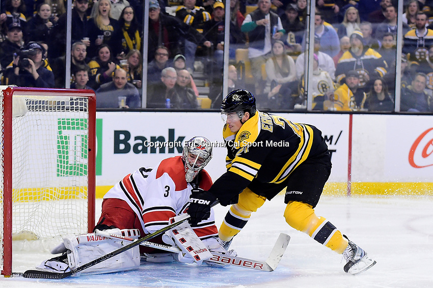 Tuesday, April 5, 2016: Boston Bruins left wing Loui Eriksson (21) pokes the puck past Carolina Hurricanes goalie Cam Ward (30) to tie the score in the third period of the National Hockey League game between the Carolina Hurricanes and the Boston Bruins held at TD Garden, in Boston, Massachusetts. Eric Canha/CSM