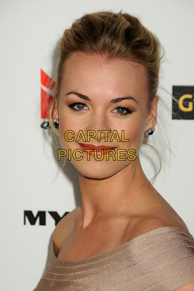 YVONNE STRAHOVSKI.Attending the 2010 G'Day USA Australia Week Black Tie Gala held at the Hollywood & Highland Grand Ballroom, Hollywood, California, USA, .16th January 2010..arrivals portrait headshot hair up earrings beige .CAP/ADM/BP.©Byron Purvis/Admedia/Capital Pictures