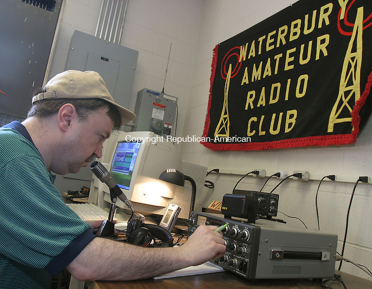 PROSPECT, CT -25 June 2005 -062505BZ01- Pete Miller, of Prospect, operates a radio on the 80 meter band from the Prospect Volunteer Fire Department's emergency operations center during the American Radio Relay League's annual Field Day Saturday afternoon. <br /> Jamison C. Bazinet Photo
