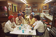 Kansas City, Missouri, September 9, 1978. Moment of rest at the Truck Stop. Truck drivers are driving about 6,000 miles a week. Sharing a meal or a pool with friends speaking about mechanichs, performance, and exchanging their CB handle is the best moment of the day.