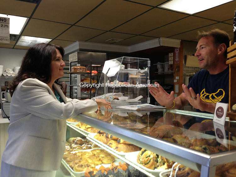 WOODBURY, CT - 27 Aug 2014 - 082714RH01 - New Region 14 Superintendent Anna Cutaia-Leonard, left, speaks with Ovens of France owner Denis Niez in Woodbury before meeting with district teachers and staff the day before school starts. She won't officially join the district until October. Rick Harrison Republican-American