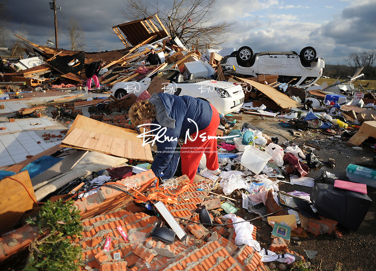 Colleen Conner salvages items at Bonnie Scott's house in Oxford, Miss. on Wednesday, February 6, 2008. Scott escaped serious injury when the storm destroyed her house while she was in it.