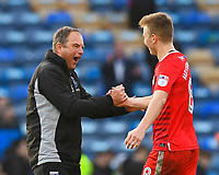 Gillingham Manager Steve Lovell left celebrates with Jake Hessenthaler of Gillingham at the final whistle during Portsmouth vs Gillingham, Sky Bet EFL League 1 Football at Fratton Park on 10th March 2018