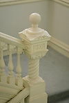 A stair newel on the main staircase, leading down to the basement.