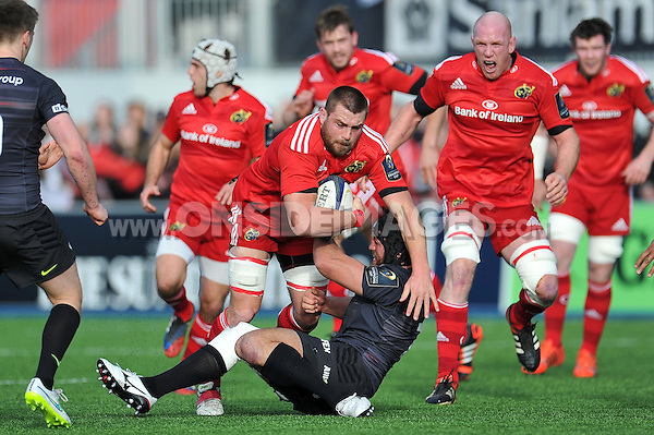 CJ Stander of Munster is tackled to ground. European Rugby Champions Cup match, between Saracens and Munster on January 17, 2015 at Allianz Park in London, England. Photo by: Patrick Khachfe / JMP