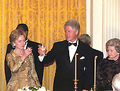 United States President Bill Clinton and first lady Hillary Rodham Clinton toast the 200th  Anniversary of the White House at a dinner in the East Room in Washington, DC on November 9, 2000.  At far right is former first lady Lady Bird Johnson.<br /> Credit: Ron Sachs / CNP