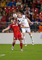 28 September 2010: Real Salt Lake defender Nate Borchers #6 and Toronto FC forward Chad Barrett #19 in action during a CONCACAF Champions League game between Real Salt Lake and Toronto FC at BMO Field in Toronto..Final score was 1-1...