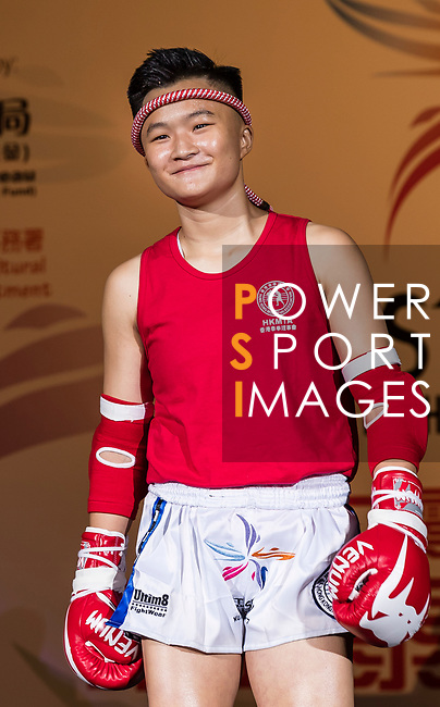 Tsang Ching Yee (Red) of Hong Kong enters to the ring prior the female muay 54KG division weight bout against Tsai Yu Shiuan (Not in picture) of Taiwan during the East Asian Muaythai Championships 2017 at the Queen Elizabeth Stadium on 11 August 2017, in Hong Kong, China. Photo by Yu Chun Christopher Wong / Power Sport Images