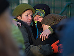 © Joel Goodman - 07973 332324 . 26/01/2014 . Salford , UK . Protesters hug and cry in front of the gate to the iGas fracking site . Protesters march to an iGas fracking exploration site at Barton Moss , Salford , today (Sunday 26th January 2014) . A long term protest camp has been established on an access road leading to the site and today (26th January) protesters from other areas of the country travelled to the site to join with other protesters against fracking . Photo credit : Joel Goodman