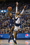 Akron guard Loren Cristian Jackson (1) shoots over the arm of Nevada's Cody Martin (11) in the second half of an NCAA college basketball game in Reno, Nev., Saturday, Dec. 22, 2018. (AP Photo/Tom R. Smedes)