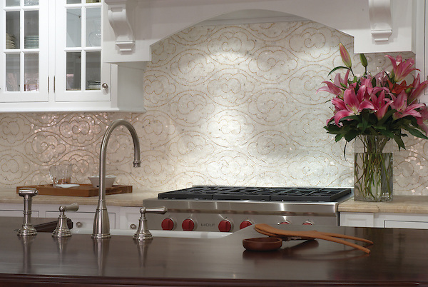 This custom kitchen features a Tatewaku mosaic backsplash shown in Calacatta Tia and polished Gascogne Blue, a part of the Silk Road Collection by Sara Baldwin for New Ravenna. <br />