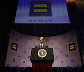 "Washington, DC - October 10, 2009 -- United States President Barack Obama delivers remarks at the Human Rights Campaign National Dinner in Washington, DC on Saturday, October 10, 2009.  In his remarks, the President restated his campaign pledge to repeal the doctrine of ""don't ask-don't tell"" and allow homosexual men and women to serve openly in the armed forces. Obama also stated his strong support for ending discrimination against bisexuals, gays, lesbians and transgender people..Credit: Yuri Gripas / Pool via CNP"
