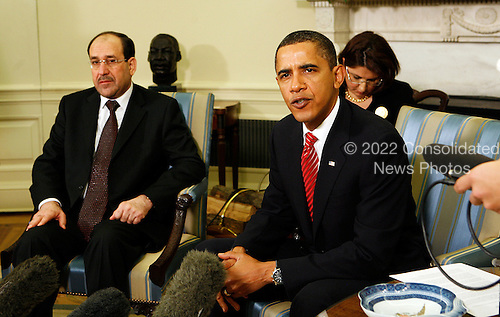 Washington, DC - October 20, 2009 -- United States President Barack Obama and Prime Minister Nouri Al-Maliki of Iraq speak to the Press after a bilateral meeting in the Oval Office of the White House, Washington, DC, Tuesday, October 20, 2009. .Credit: Aude Guerrucci / Pool via CNP