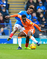 Marc Bola of Blackpool holds off Jamal Lowe of Portsmouth during Portsmouth vs Blackpool, Sky Bet EFL League 1 Football at Fratton Park on 12th January 2019