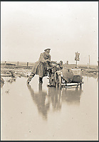 BNPS.co.uk (01202 558833)<br /> Pic: Pen&amp;Sword/BNPS<br /> <br /> Ivan&rsquo;s colleague Griffiths with the motorbike and sidecar, stuck in a waterlogged landscape in the Ypres Salient. The sign behind shows that they are in Wieltje on the north-east side of Ypres.<br /> <br /> A poignant collection of images which were taken by a photographer who documented the graves of fallen soldiers on the Western Front have come to light in a new book.<br /> <br /> Ivan Bawtree was one of only three professional photographers assigned to the the Graves Registration Units to photograph and record the graves of fallen First World War soldiers on behalf of grieving relatives. <br /> <br /> His powerful photos of northern France and Flanders are a haunting reminder of the horrors of war and a fascinating insight into the early work of the Imperial War Graves Commission. <br /> <br /> Prior to the First World War, the casualties of war were generally buried in unmarked mass graves.