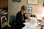 March 17, 2009. Raleigh, NC.. Images from one day in the life of Deborah K. Ross, Representative for North Carolina House District 38.. 9:55 AM. Ross reviews the governor's budget, that will be discussed later in the day due to proposed cuts stemming from the economic crisis gripping the state and country.