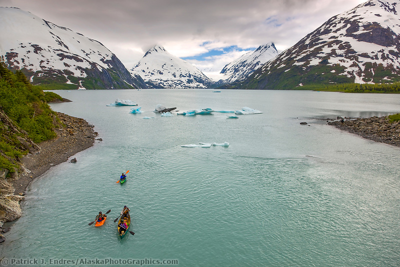 Paddlers enjoy the views on Portage lake, southcentral, Alaska